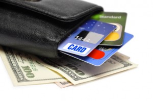 credit cards and dollar banknotes